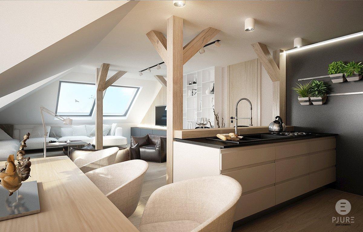 Půdní prostory mají svou přirozenou atmosféru, která se dá podtrhnout dobrým řešením. V tomto prostoru navrhli architekti studia PJURE obývací pokoj propojený s kuchyní.