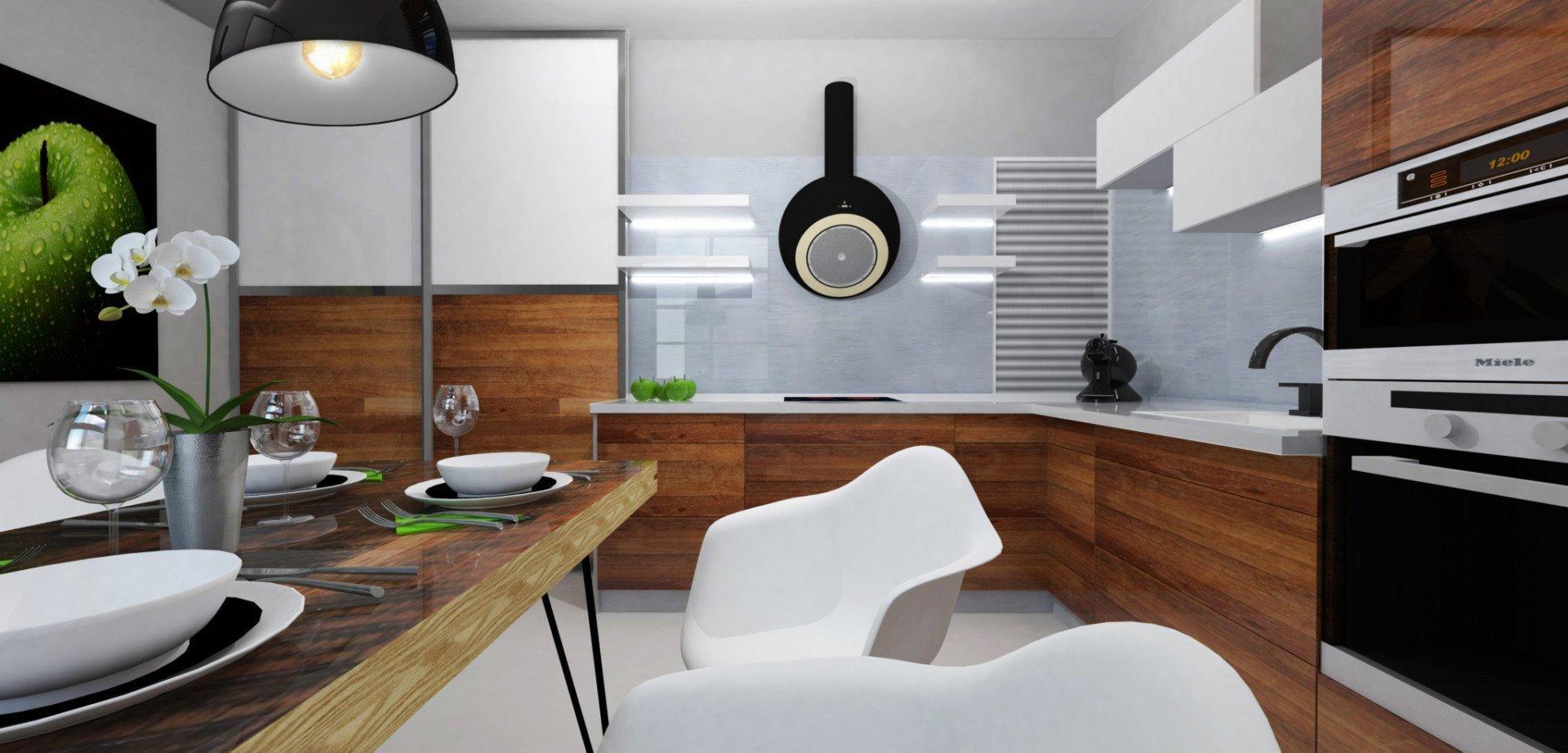 """,,Není kuchyň jako kuchyň.""""  Světlý čistý prostor s dominantními černými prvky, doplněný o teplé dřevěné materiály a oživený přírodní zelení.  ,,Na…"""