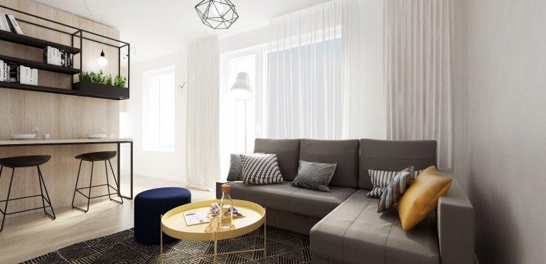Útulný dvojizbový byt v Dúbravke je v znamení chlapského interiéru s dôrazom na funkčnosť a kontrastný dizajn.