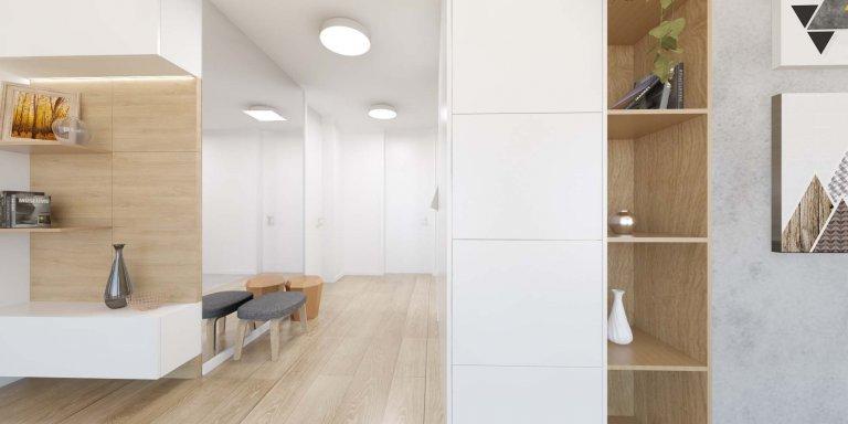 Minimalistický interiér s akcentujúcimi doplnkami.