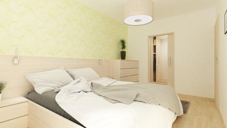ložnice se zelenou tapetou