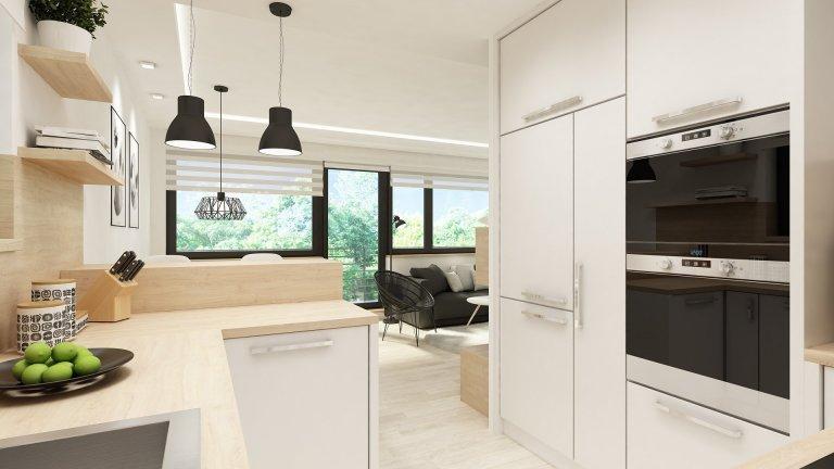 Moderní obývací pokoj s kuchyní ve skandinávském stylu.    Mladý pár si pořídil starší panelákový byt 3+1 v Berouně a jejich přáním bylo propojit…