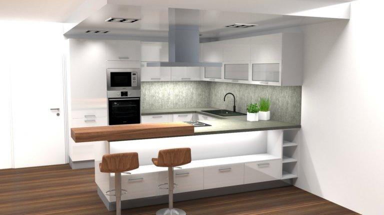 Moderní bílá kuchyně ve tvaru U s praktickým zakomponováním jídelní deskyse hodí do bytu s menší kuchyní.